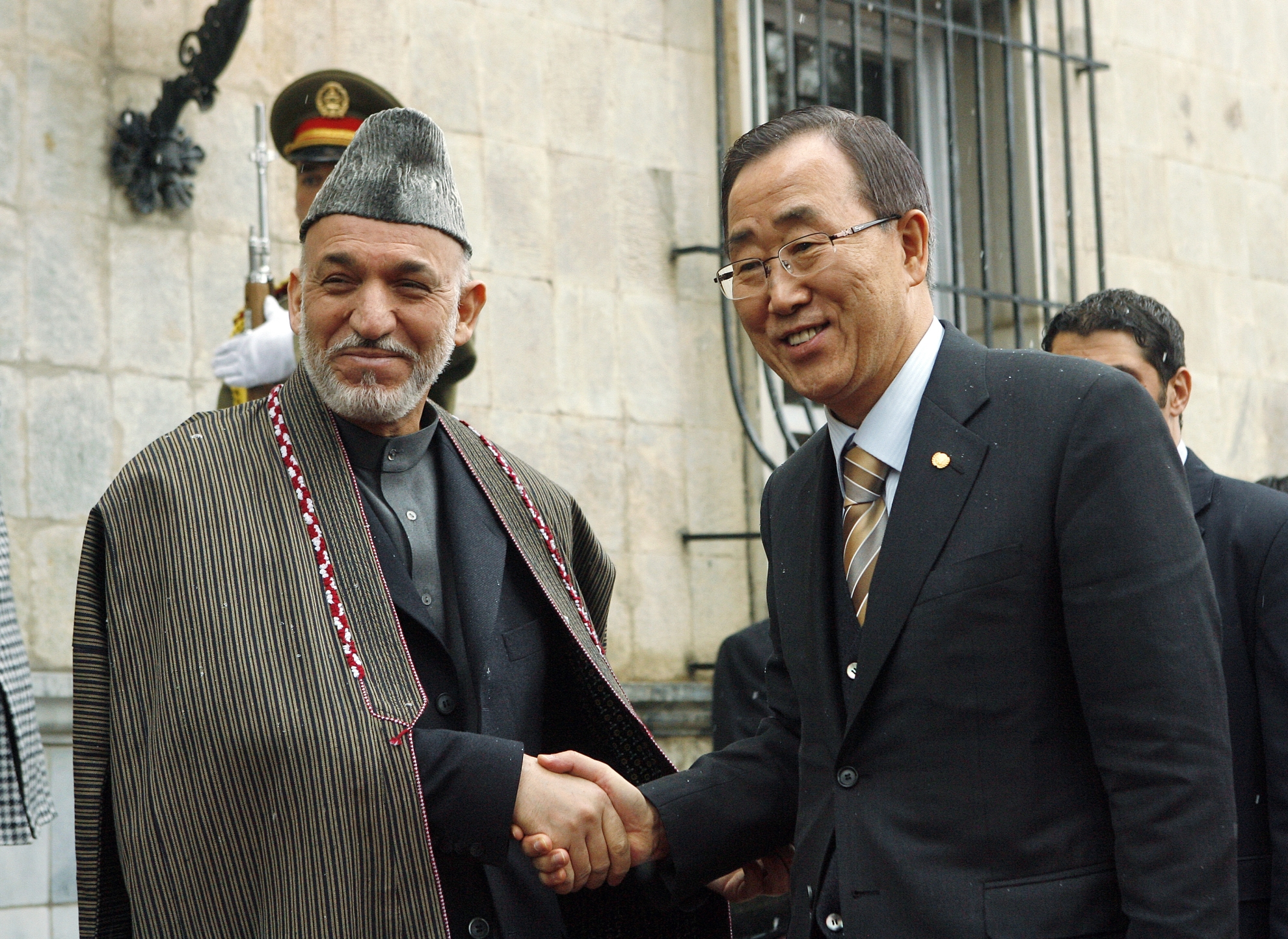 Former president Hamid Karzai has sought to demonstrate ethnic inclusion through his choice of dress: His coat is a 'chapan', traditionally worn by Uzbeks and Turkmens; the hat is called 'karakul' and is widespread among Tajik citydwellers, while the loose trousers and the tunic are typically Pashtun. The Western-style coat at the same time signifies modernity and an extended hand to the West. Here he is seen with UN Secretary-General Ban Ki Moon in 2009. Photo: UN Photo/Evan Schneider