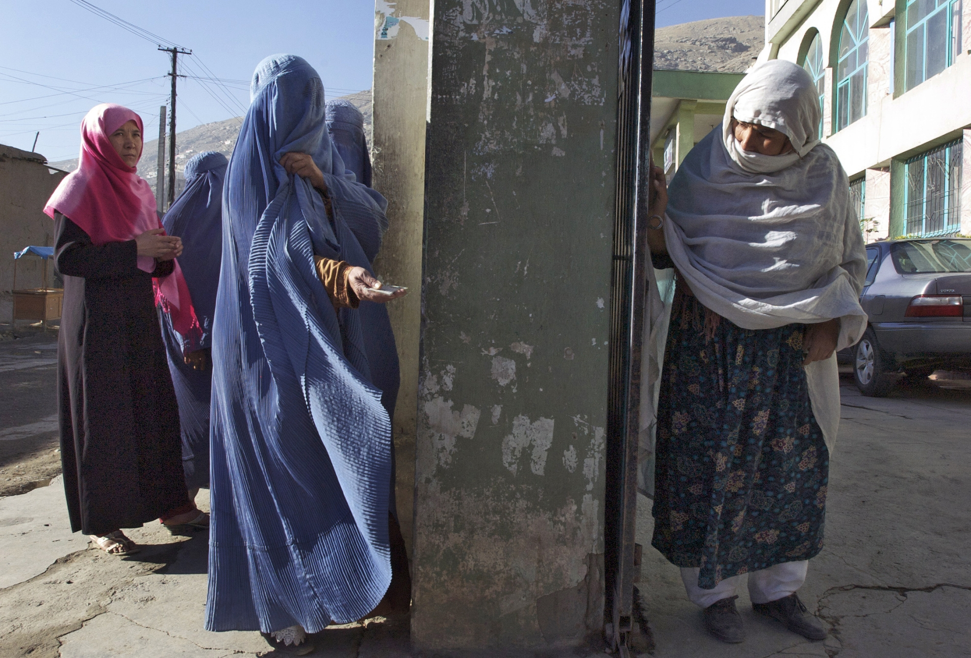 Women at the polling booth, 2009. Elections in Afghanistan have thus far been characterised by very low participation of women. In the 2005 election, only 10 percent of the registered voters were women. Photo: UN Photo/Eric Kanalstein