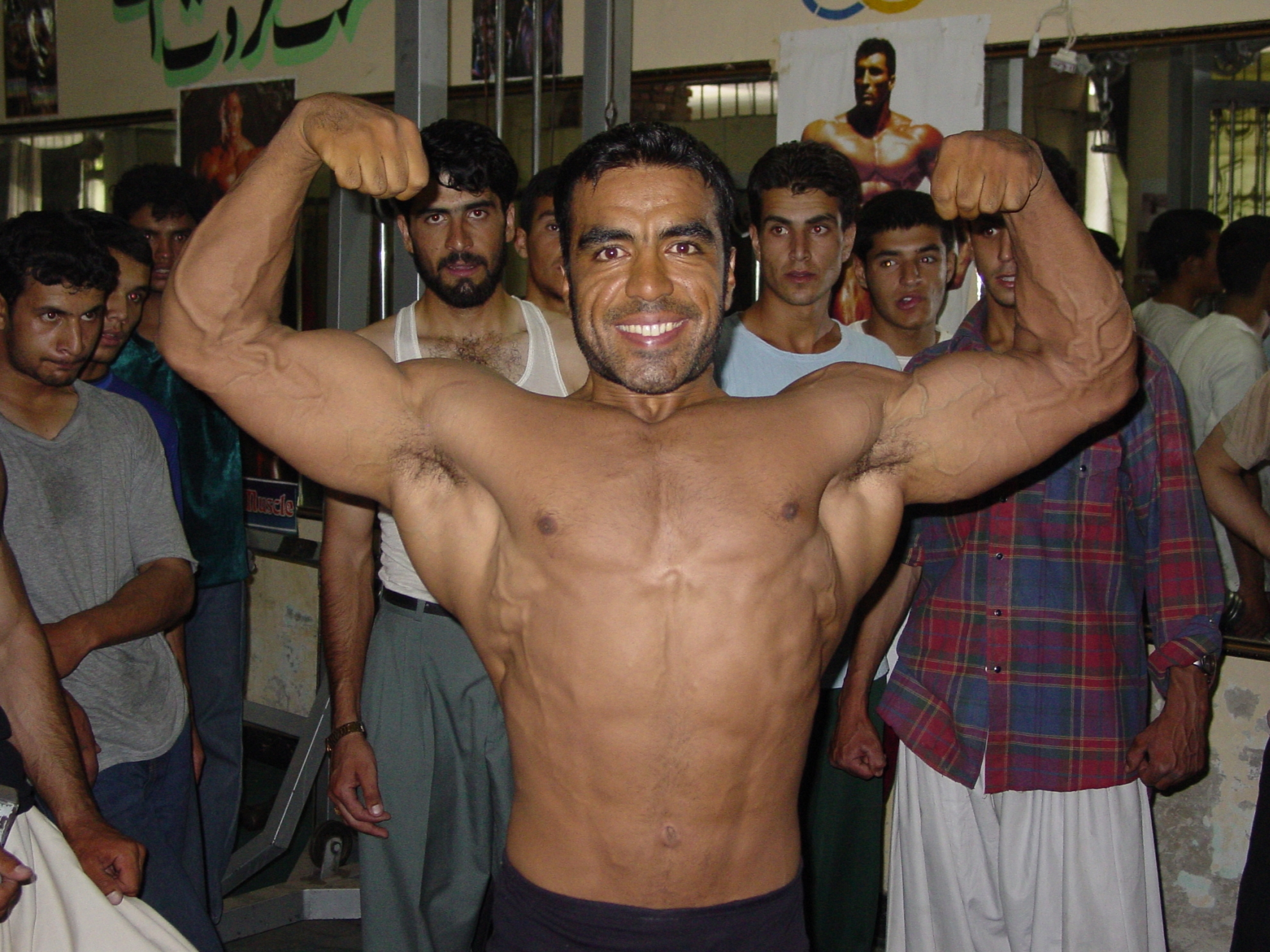 """I have studied Arnold Schwarzenegger's career in detail. He accomplished everything he strove for. I too have dreams."" So says Noorulhoda Shirzad. He is one of Afghanistan's many bodybuilders who uses workout to create a meaningful existence in a society marked by tragedy. Photo: Jens Kjær Jensen, 2003"