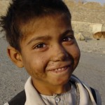 It is not difficult to find a smile and a twinkle in the eye among the refugee camp children. Photo: Jens Kjær Jensen, 2003