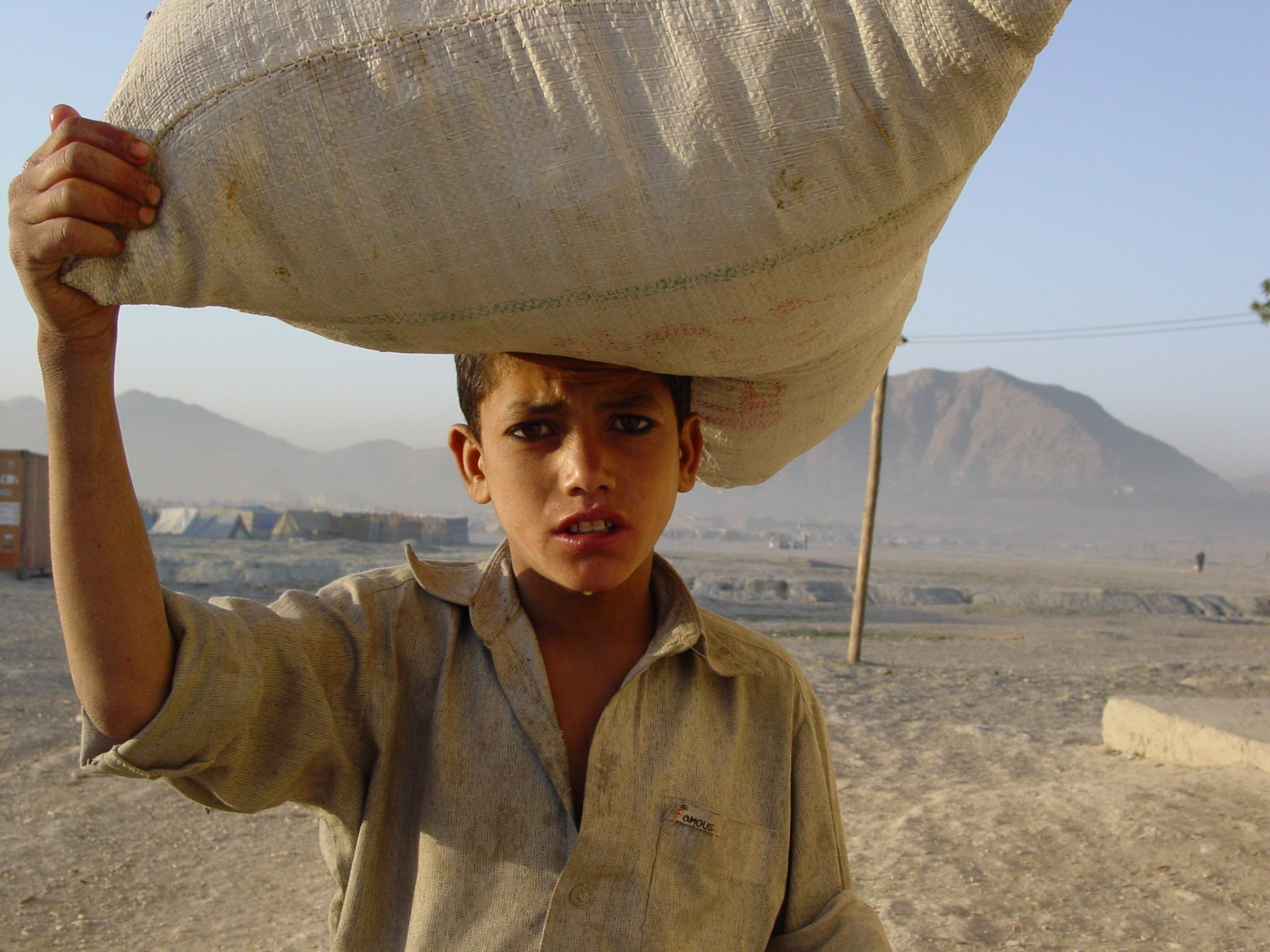"""""""I live here with my mum and my two younger siblings. We came to Kabul one year ago. Last winter was horrible, but now we've gotten some blankets and warm clothes"""". Photo: Jens Kjær Jensen, 2003"""