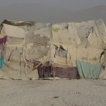 Most tents in the camp are made of old pieces of cloth patched together. Photo: Jens Kjær Jensen, 2003