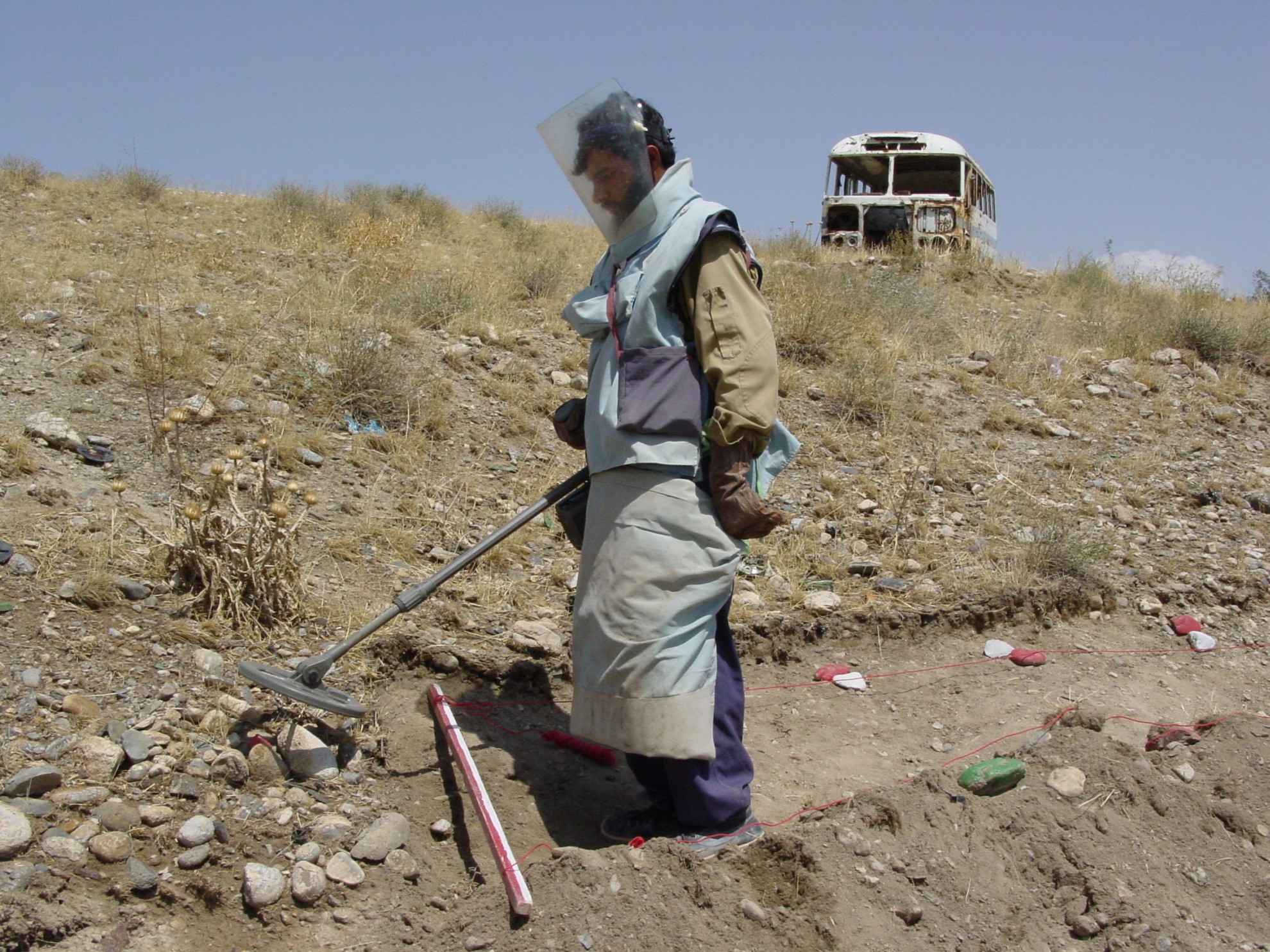Demining a hillside in Afghanistan. Photo: Jens Kjær Jensen, 2003