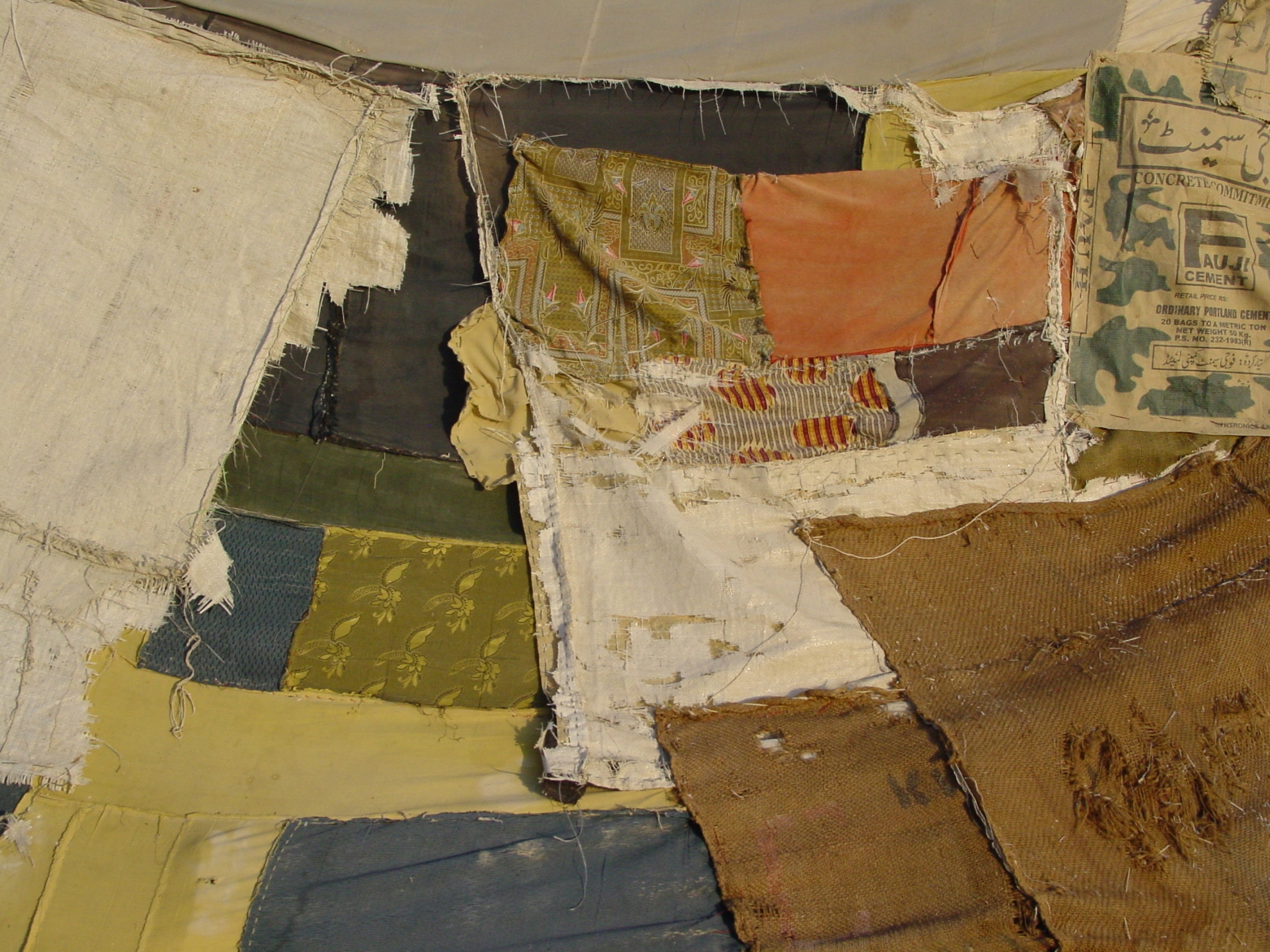 The tents in the camp have been repaired multiple times, resulting in this patchwork look. Photo: Jens Kjær Jensen, 2003