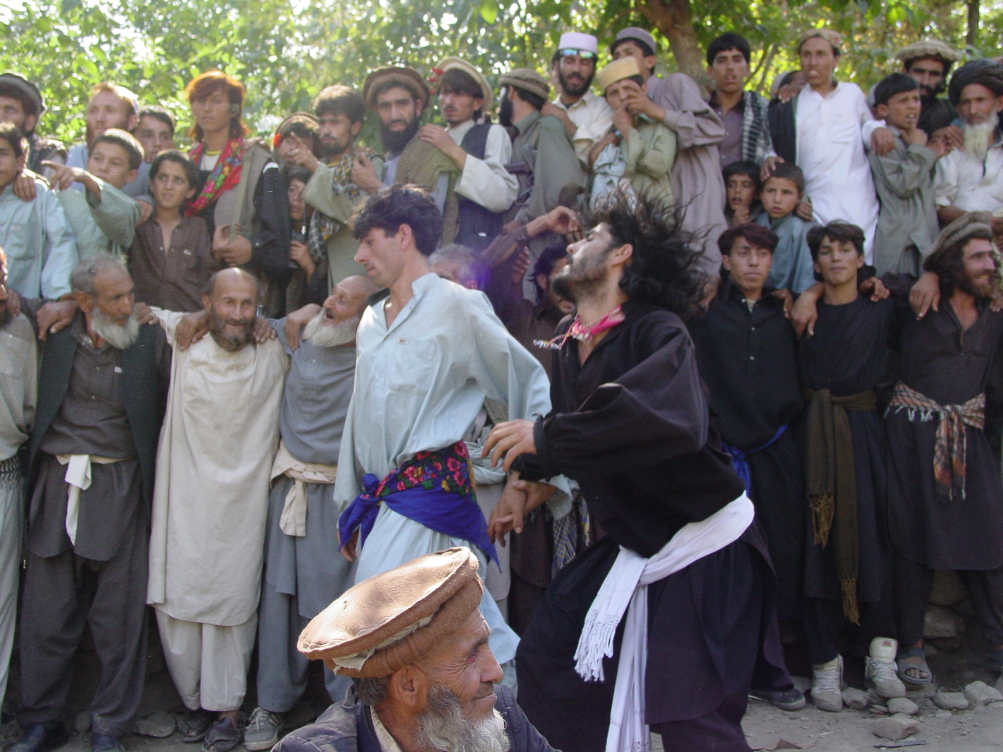 Singing and dancing were banned under the Taliban. Today, however, you see it at most weddings in the countryside. The man in black is dancing in a state of trance. Photo: Jens Kjær Jensen, 2003