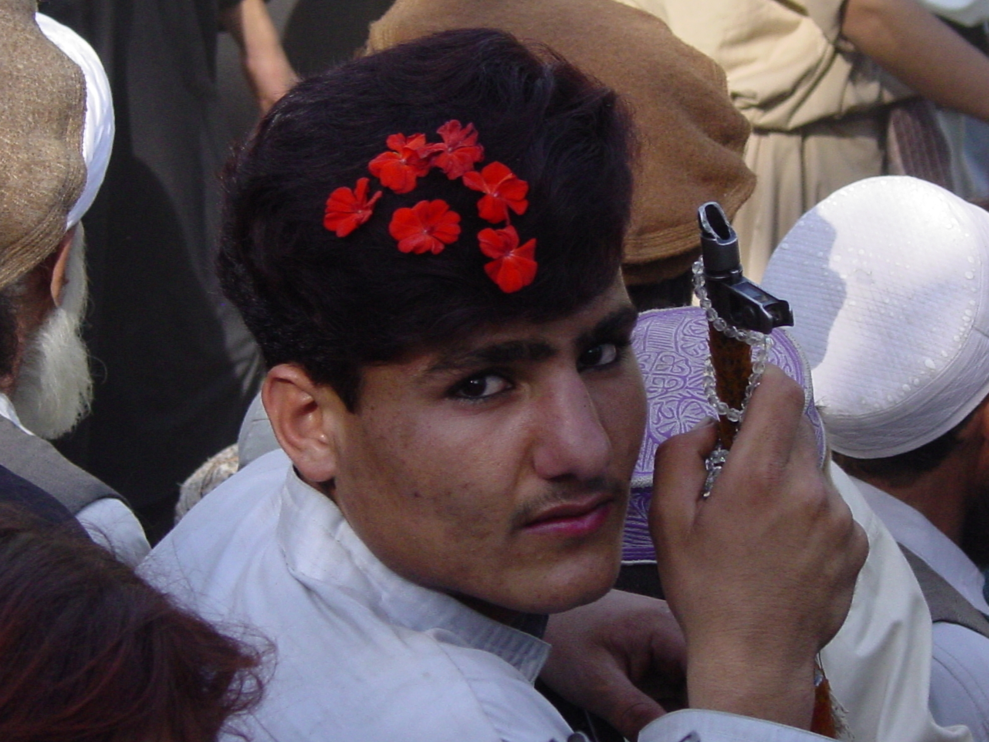 Many boys and men adorn themselves with flowers and make-up when attending a wedding. Photo: Jens Kjær Jensen, 2003
