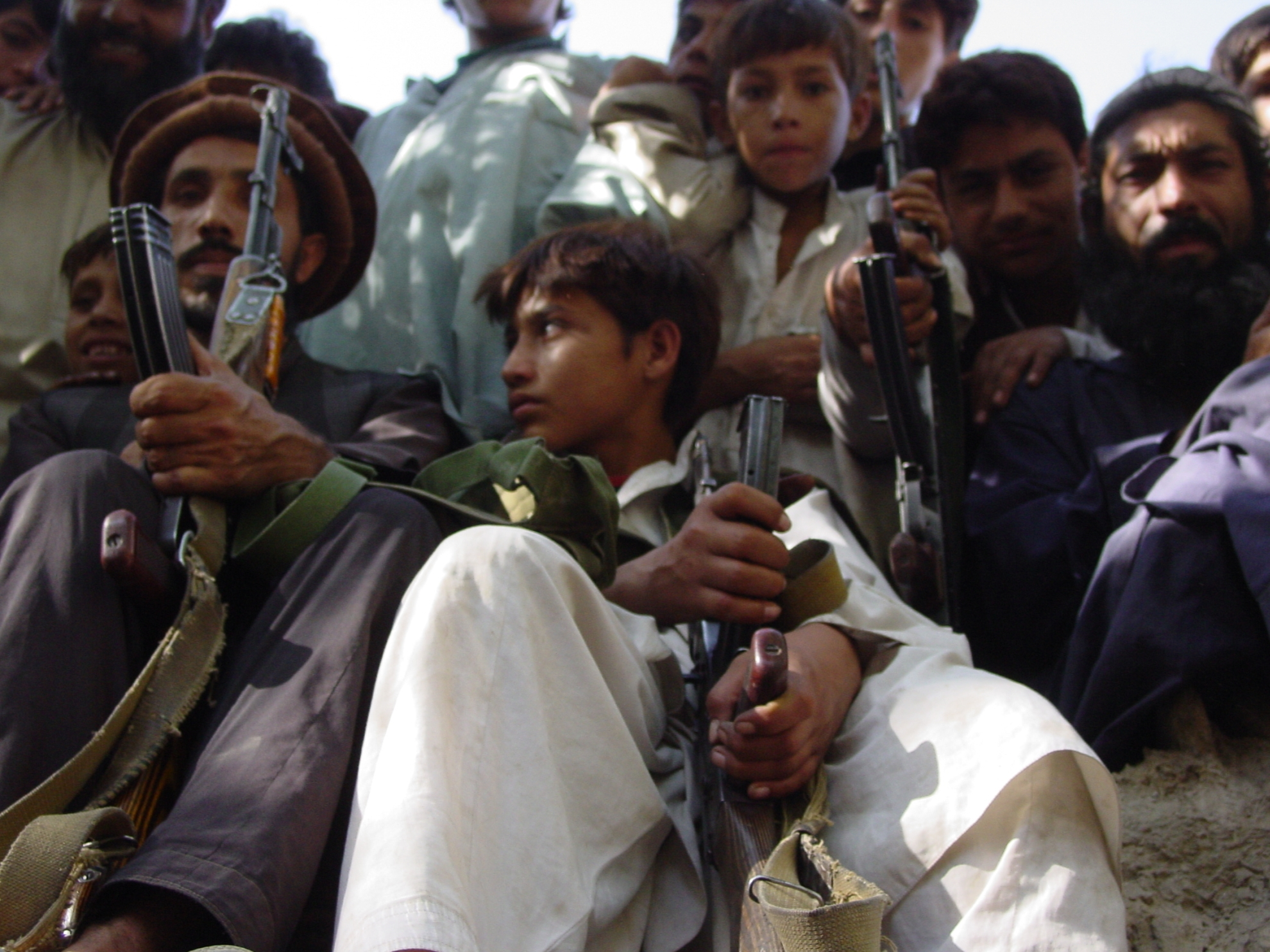 In the mountain regions of Afghanistan, it is common practice to bring along your AK-47 to a party. The gun, whish is also known as a kalashnikov, is very popular as it is easy to repair. Photo: Jens Kjær Jensen, 2003