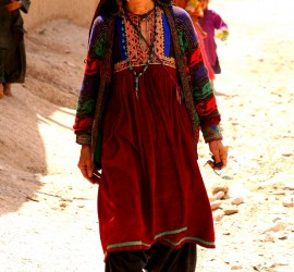 Woman in traditional Afghan dress. Photo: Tahir Bakhtiary, 2013