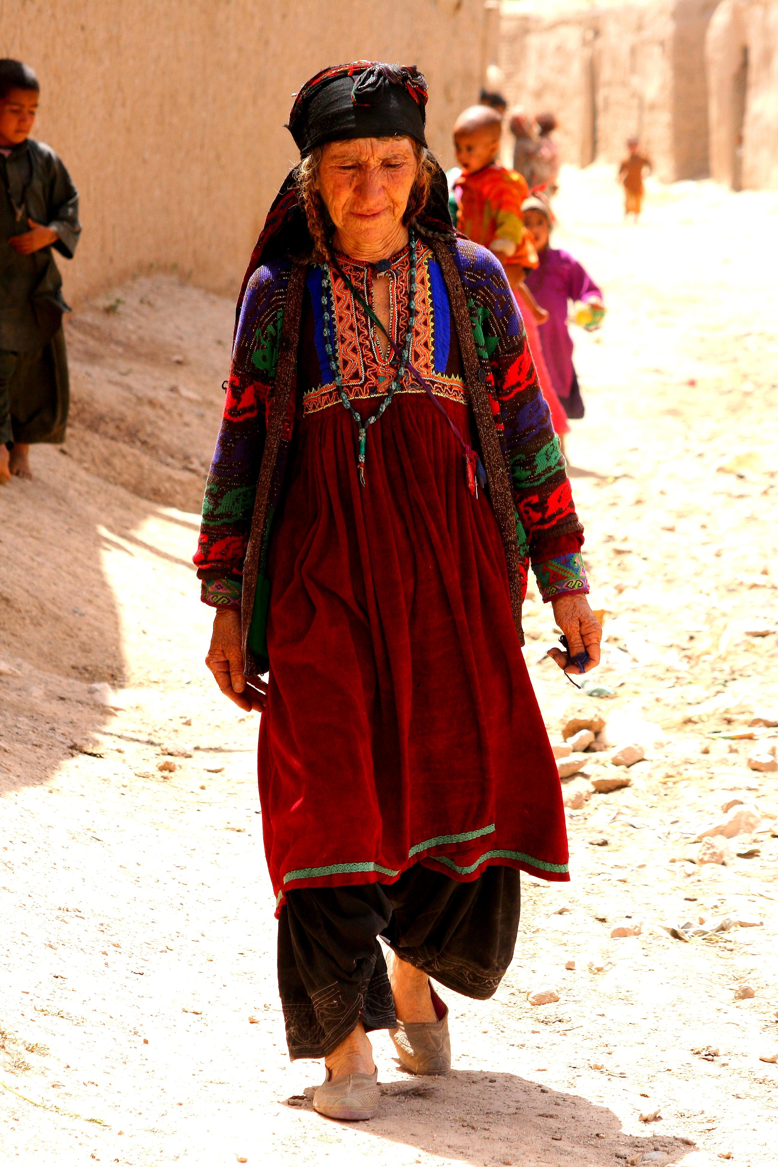 Woman in traditional Afghan dress. Photo: Tahir Bakhtiary, 2013