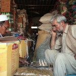 Playing chess while waiting for the customers. Photo: Tahir Bakhtiary, 2013