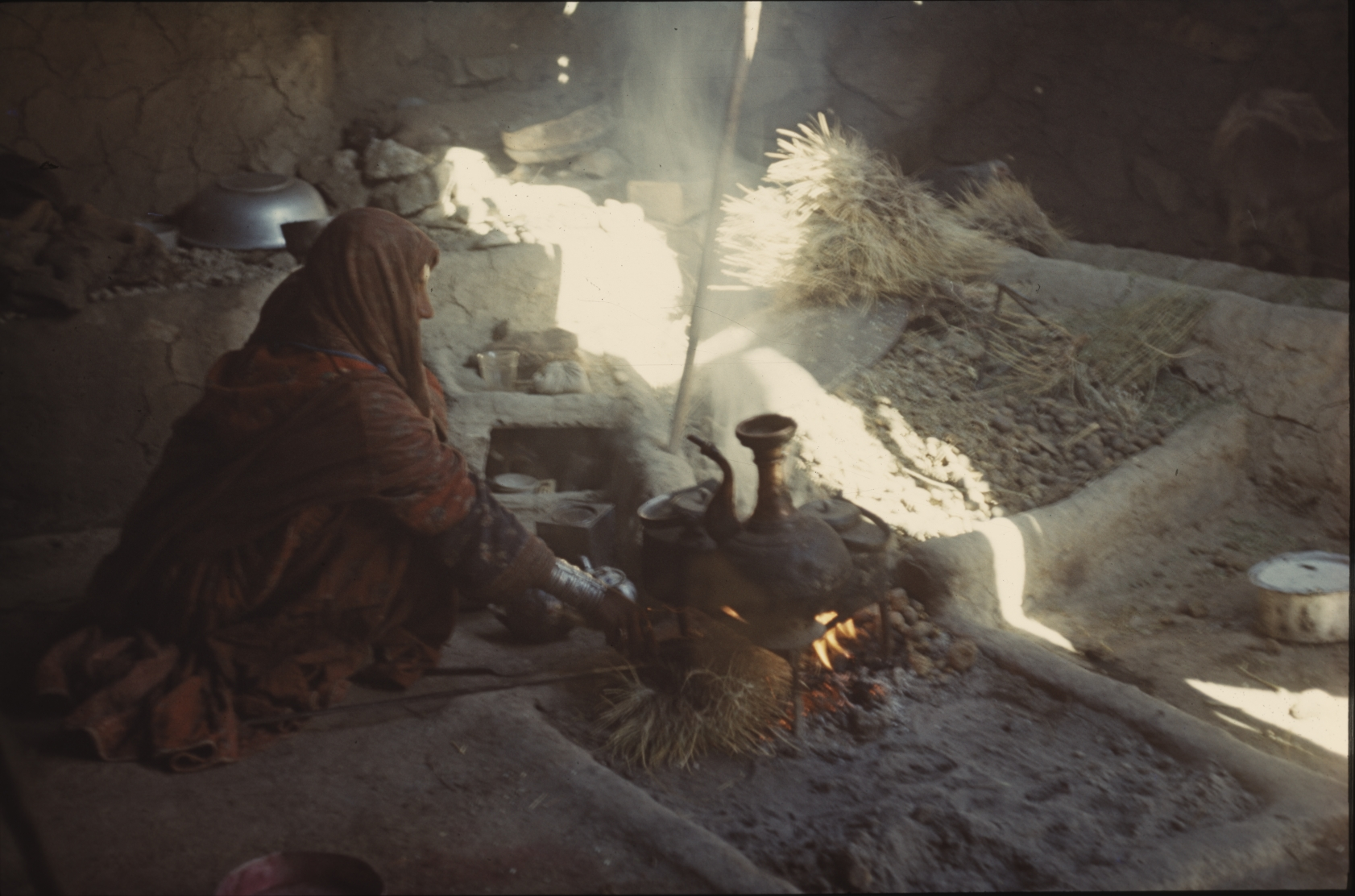 Food and tea are made over an open fire. That is a woman's job. Photo: Jean Bourgeois, 1969