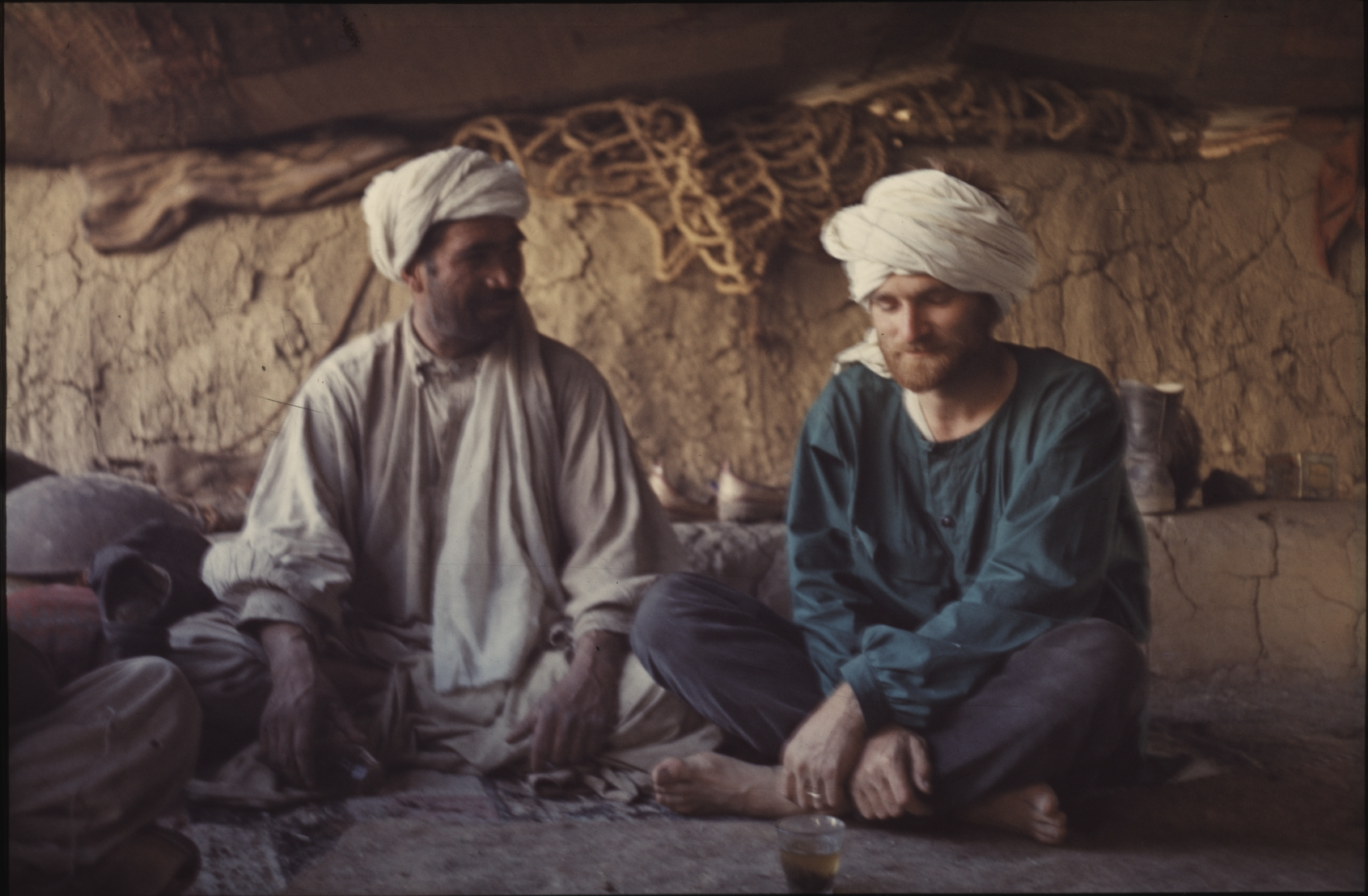 Jean having tea with his Afghan host. Photo: Daniella Bourgeois. 1969
