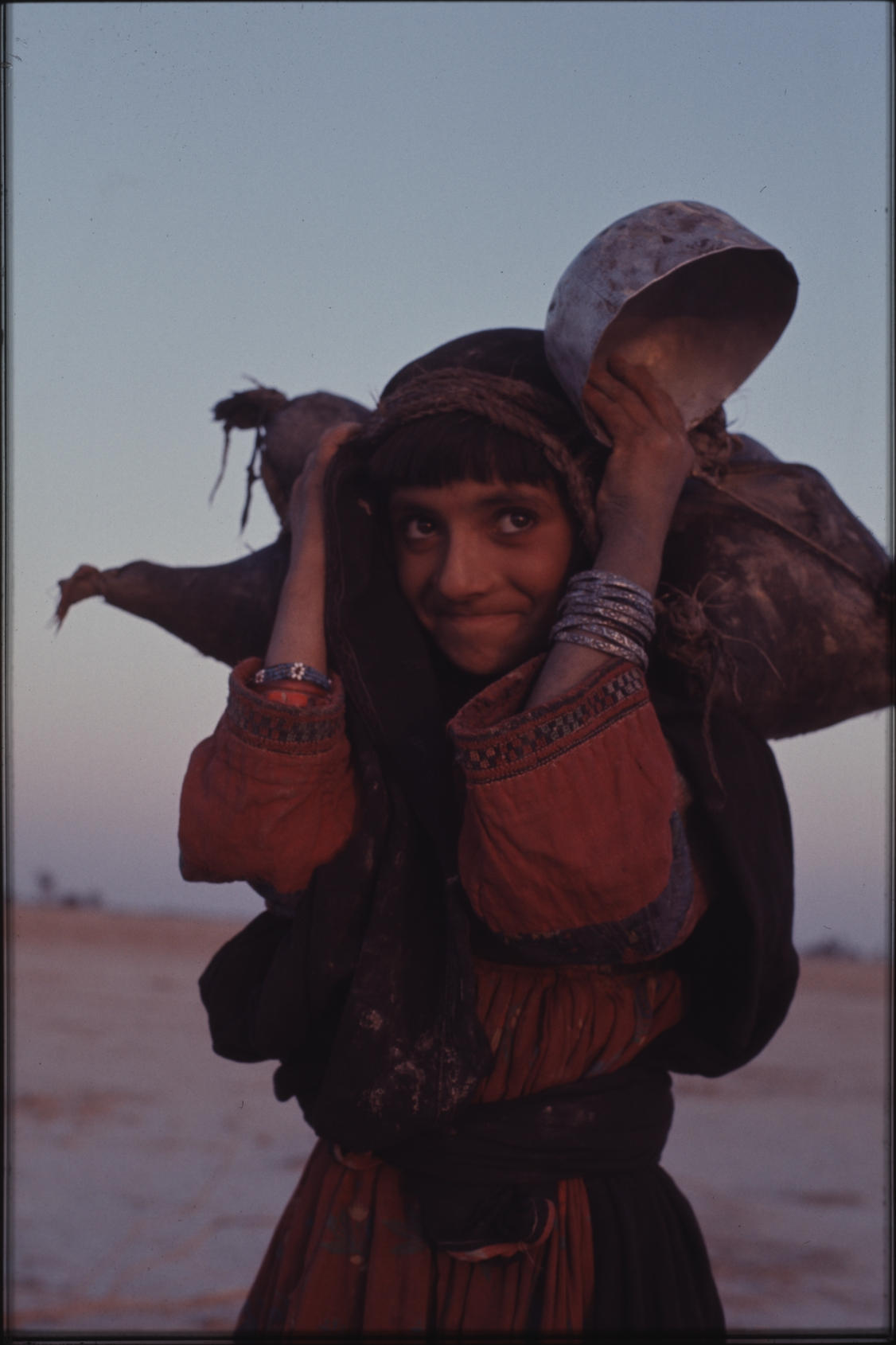 Fetching water can be hard work – but also an opportunity to hang out with the other girls. Photo: Jean Bourgeois, 1971