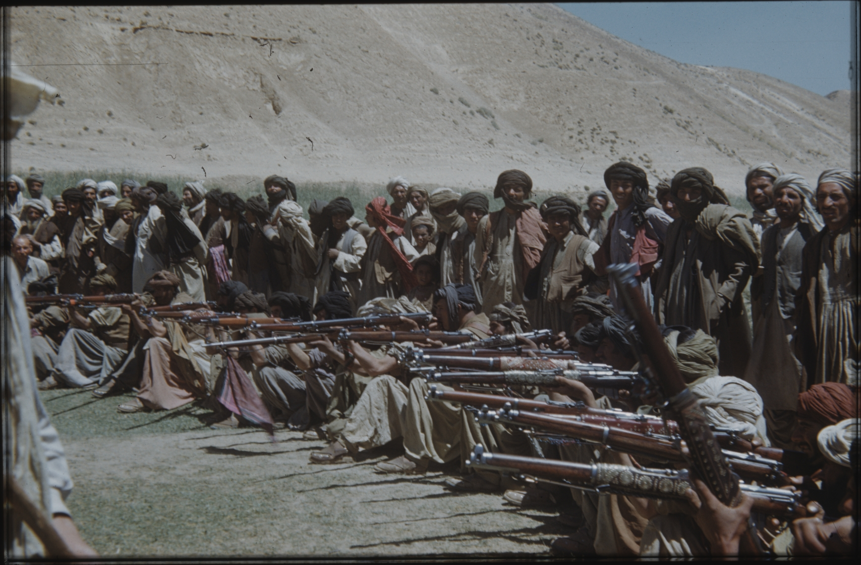 A nomad must be able to defend himself and his family. Thus, he is usually armed. Here a shooting performance at the nomad bazaar. The Henning Haslund-Christensen Memorial Expedition, 1953-'55. Photo: the Moesgaard Museum archives