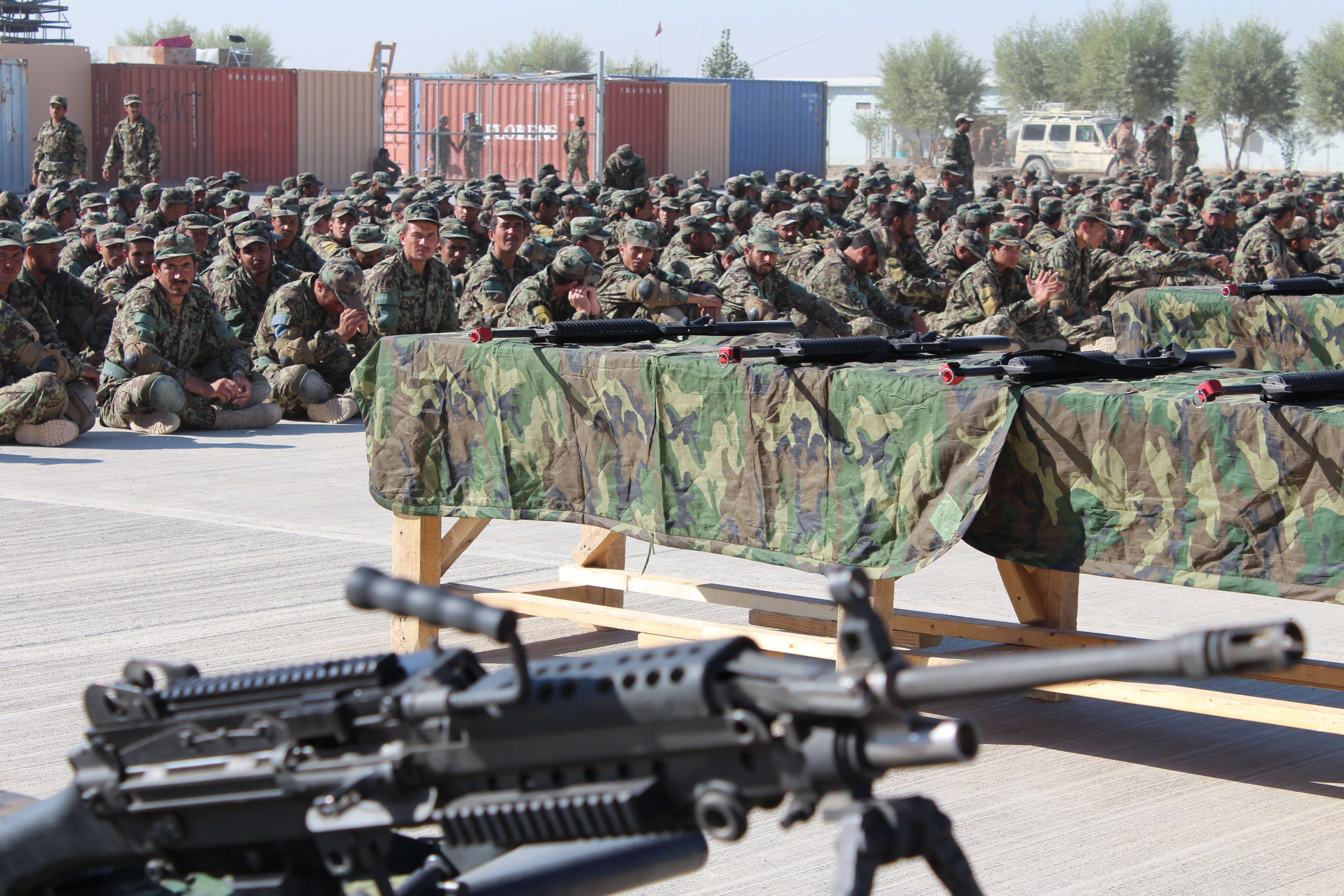 An oath is taken by a selection of weapons from the infantry group. When the Western soldiers leave, it will be up to the Afghan soldiers in the picture to establish security in the country. Photo: HOK, 2008