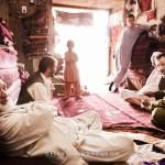 Men and boys relaxing in a carpet shop. Photo: Lars Schmidt, 2010-'13