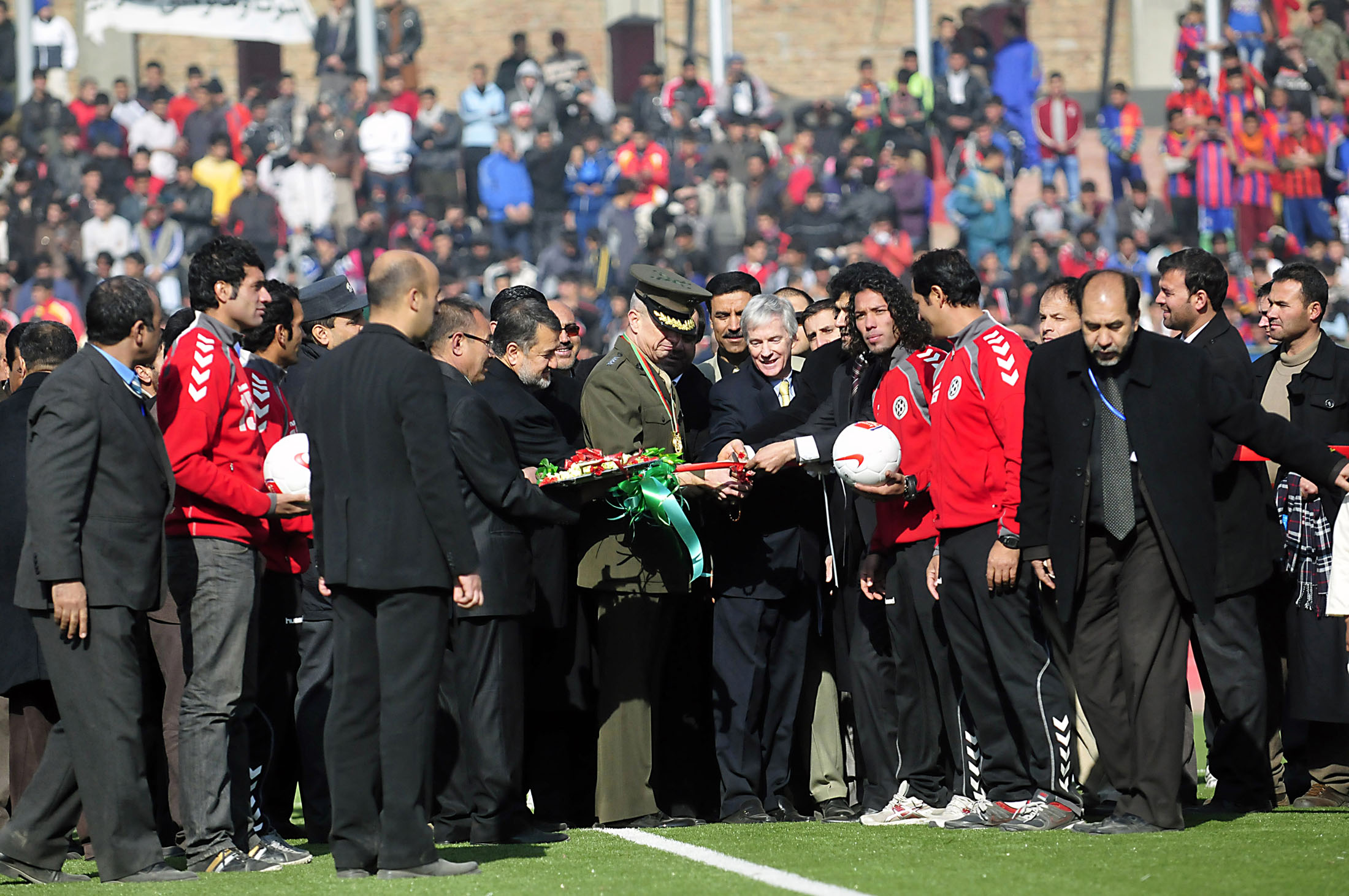 The head of the international security forces in Afghanistan and the US ambassador to the country at the official opening of the renovated Ghazi Stadium in December 2011. Photo: US Army/Master Sgt. Kap Kim