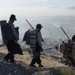 Hamid and his colleagues going home after a long day at work. Kabul is visible in the background. Photo: Jens Kjær Jensen, 2003