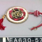 Protective plastic amulets with Quranic verses are often hung in cars.