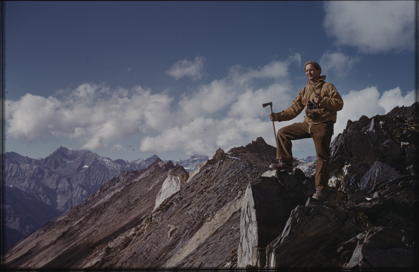 Klaus Ferdinand overlooking the mountains. This his first expedition to Afghanistan came to have a decisive influence on his future career. The Henning Haslund-Christensen Memorial Expedition, 1953-'55. Photo: the Moesgaard Museum archives
