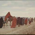 Nomads going to a wedding. The woman in the red cloak is the bride. Photo: Jean Bourgeois, 1969