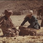 Jean was called Ajâm by the nomads. Here he helps packing a bag. While living with the nomads, Jean and Daniella took part in the daily chores. Photo: Daniella Bourgeois, 1969