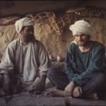 Jean having tea with his Afghan host. Photo: Daniella Bourgeois. 1969