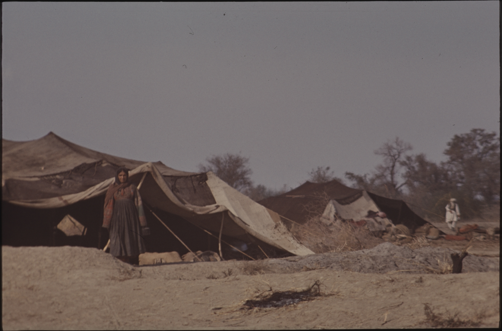 While the men care for the animals, the women are responsible for keeping the tent, cooking and raising children. This photo is from the winter camp in Pakistan. Photo: Jean Bourgeois, 1969