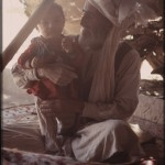 Nomad men are fond of their male children. Photo: Jean Bourgeois, 1971