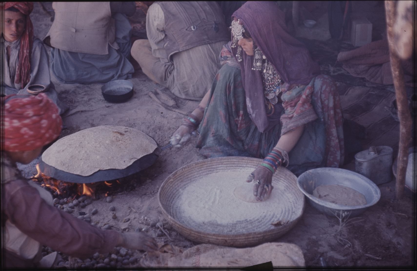The main constituent of the nomad diet is flat bread baked over an open fire. They rarely eat meat. Photo: Jean Bourgeois, 1971