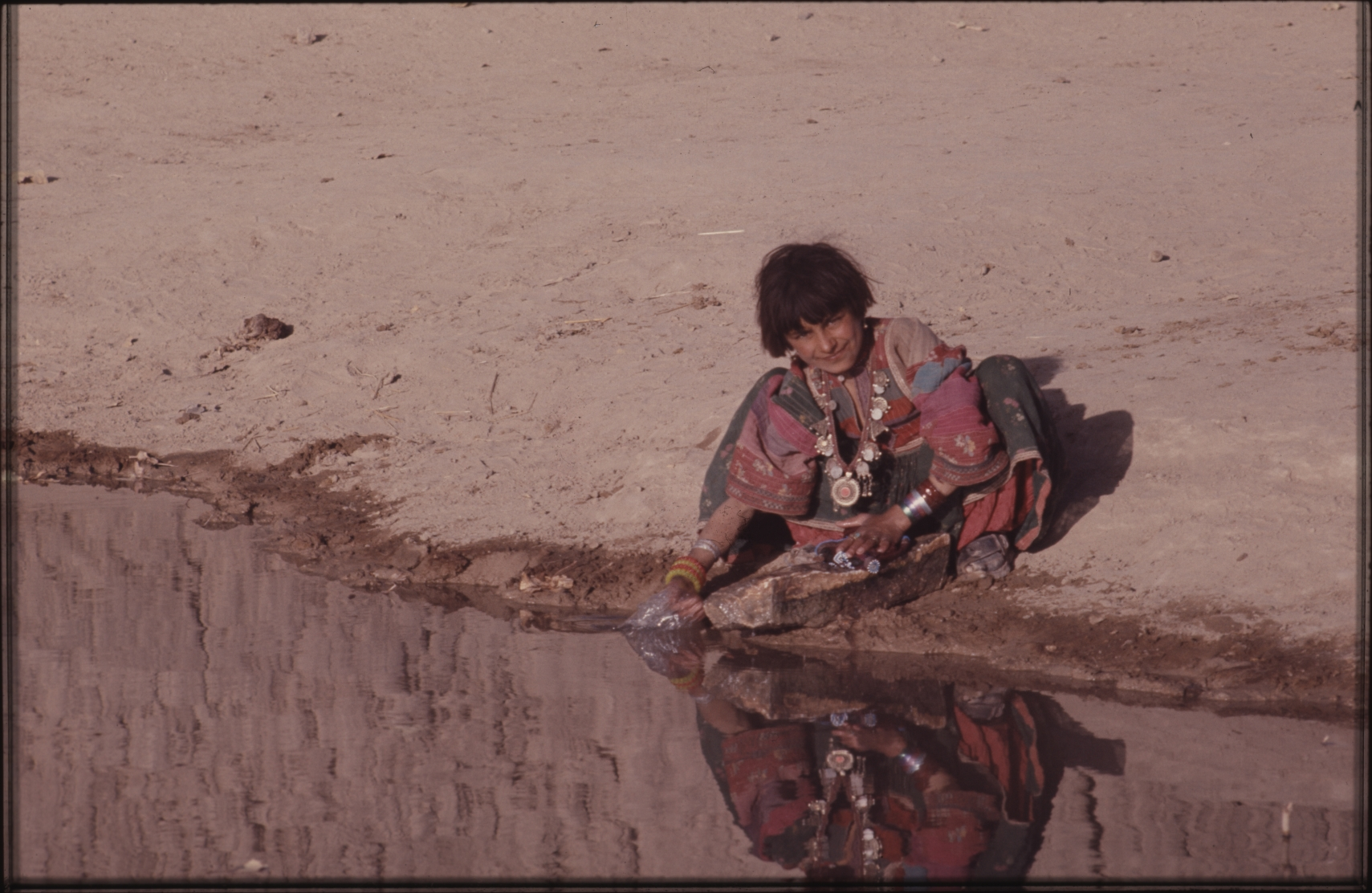 Fetching water is a girl's job. From an early age, they learn to take part in the women's chores. Photo: Jean Bourgeois, 1971
