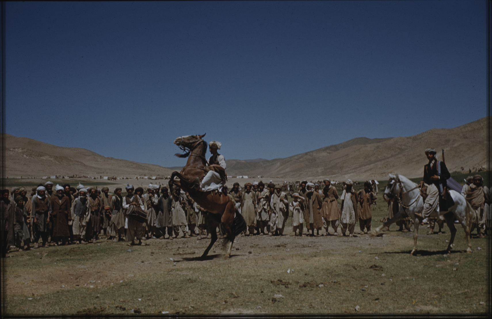 The bazaar was a meeting place for nomads from different parts of the country. Here they sold their animals, traded in all kinds of goods and put on performances. In the photo, a horseman demonstrates his skills. A few years after the expedition had documented the existence of this bazaar, it was closed down by the government. The Henning Haslund-Christensen Memorial Expedition, 1953-'55. Photo: the Moesgaard Museum archives